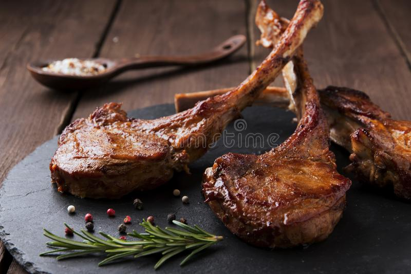 Roasted lamb ribs loin chop on a stone surface royalty free stock photo