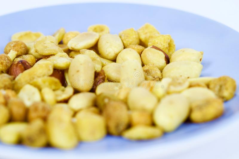 Roasted nuts ready to eat. Photo made with macro objective and in isolated background of nuts. Ideal photo to illustrate diets, healthy lifestyles, etc royalty free stock photography