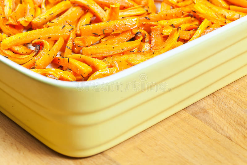 Roasted organic carrots in a tray