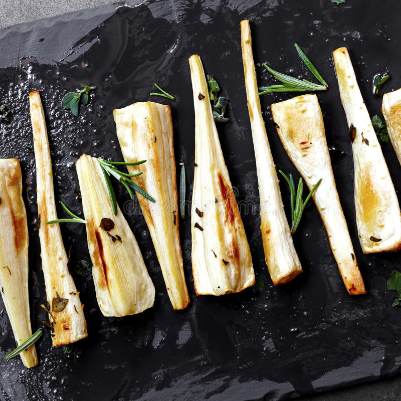 Roasted Parsnips on Slate Overhead View royalty free stock image