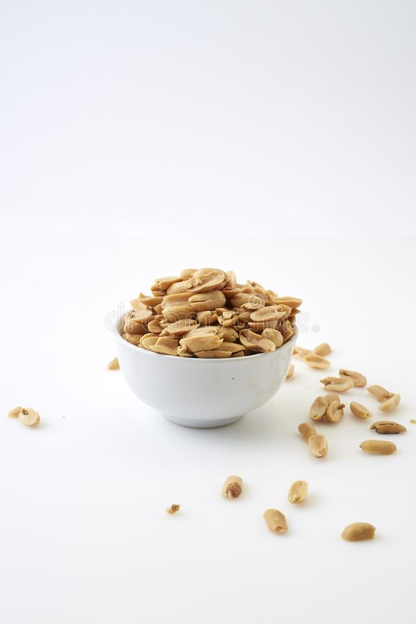 Roasted peanuts and salt in a bowl royalty free stock photography