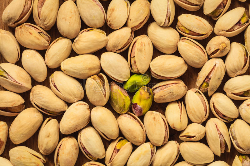 Roasted pistachio nuts seed as background stock photo