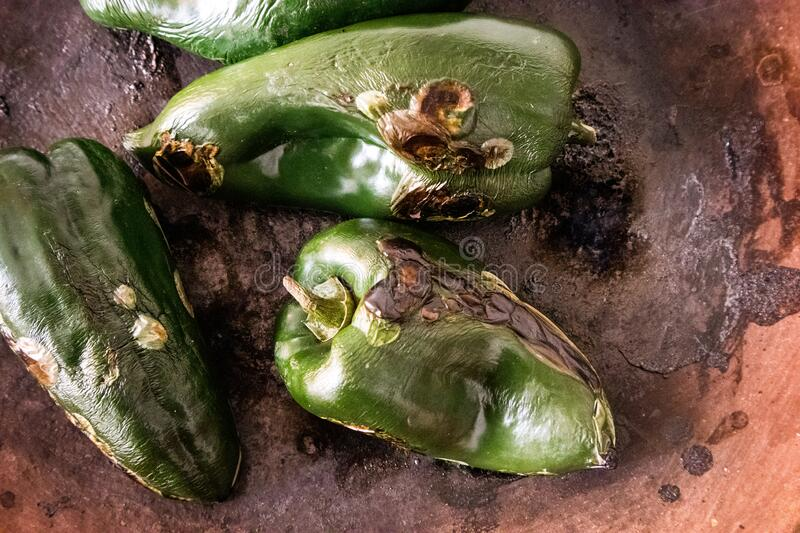 Roasted Poblano Chile Pepper in a Mexican kitchen - overhead. Roasted Poblano Chile Pepper in a Mexican kitchen at restaurant in Mexico City stock photo