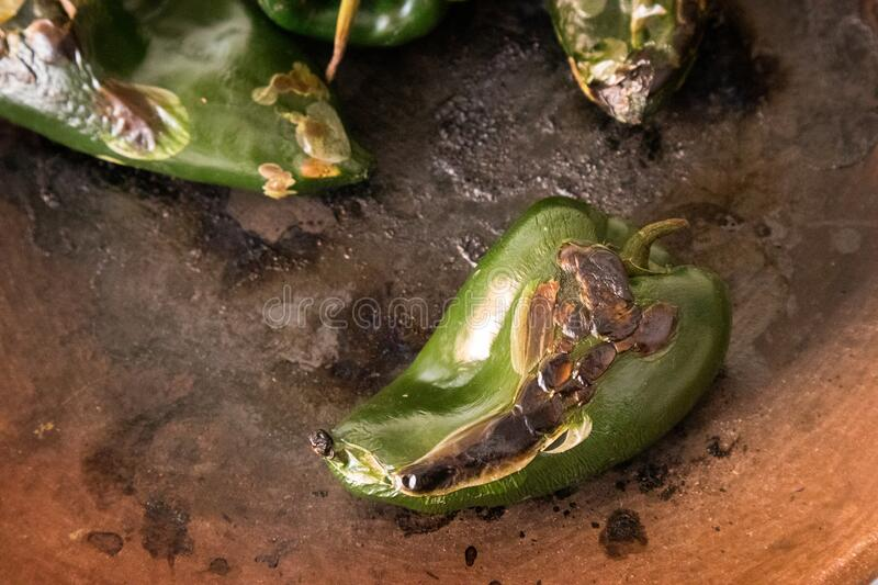 Roasted Poblano Chile Pepper in a Mexican kitchen - overhead. Roasted Poblano Chile Pepper in a Mexican kitchen at restaurant in Mexico City royalty free stock photo