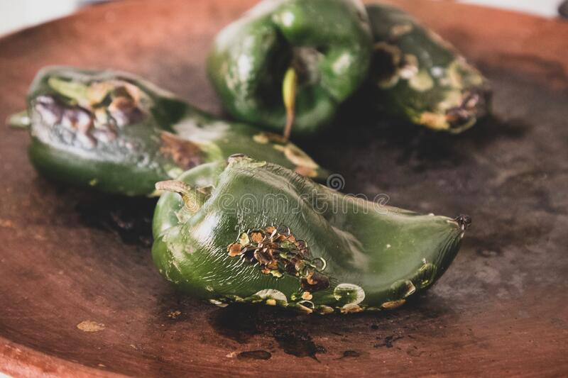 Roasted Poblano Chile Pepper in a Mexican kitchen. At restaurant in Mexico City stock photo