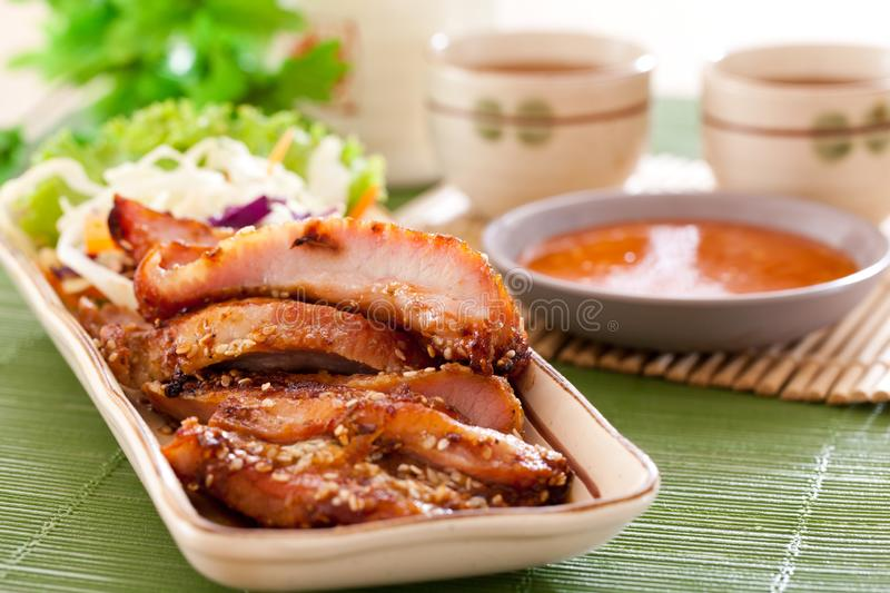 Roasted pork with sauce. Roasted pork in chinese restaurants royalty free stock photos