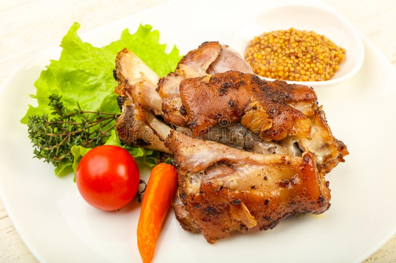 Roasted pork knee. With dijon mustard sauce stock photography