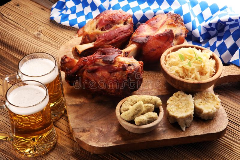 Roasted pork knuckle. Ham and bacon are popular foods in the west. German Schweinshaxe or Haxe. Roasted pork knuckle. Ham and bacon are popular foods in the stock photography