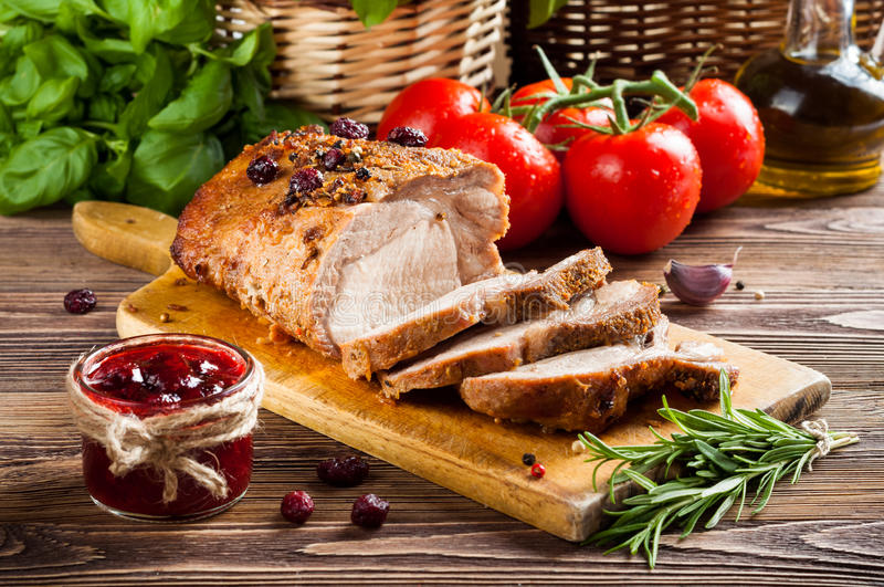 Roasted pork loin. With cranberry and rosemary royalty free stock photos