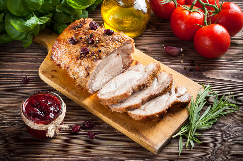 Roasted pork loin. With cranberry and rosemary royalty free stock images