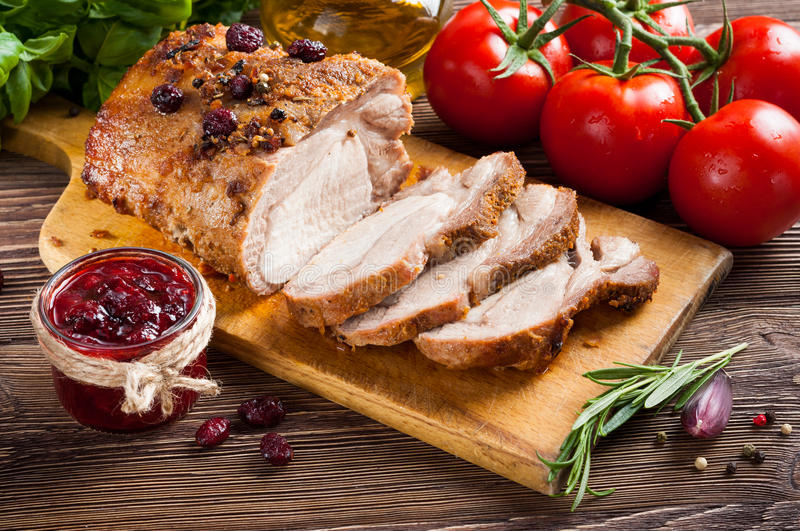 Roasted pork loin. With cranberry and rosemary royalty free stock photo