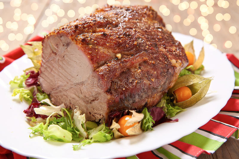 Roasted pork neck. With garlic and black pepper royalty free stock photos