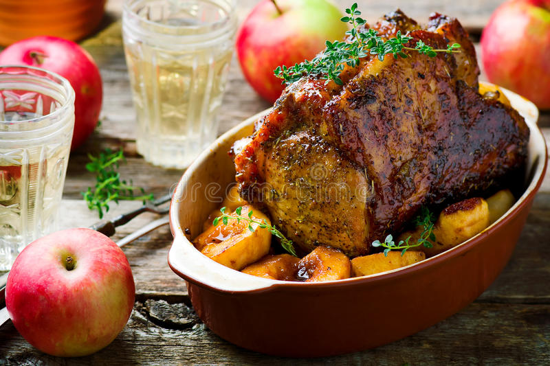 Roasted Pork Rack with Apples. Style rustic.selective focus royalty free stock photo