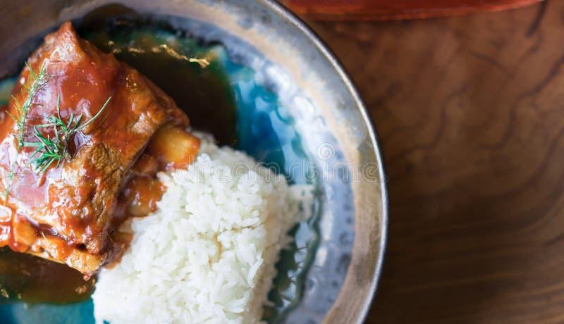 Roasted Pork Ribs with Rice at restaurant. Roasted Pork Ribs with Rice on wooden table at restaurant. Thai food concept stock photos