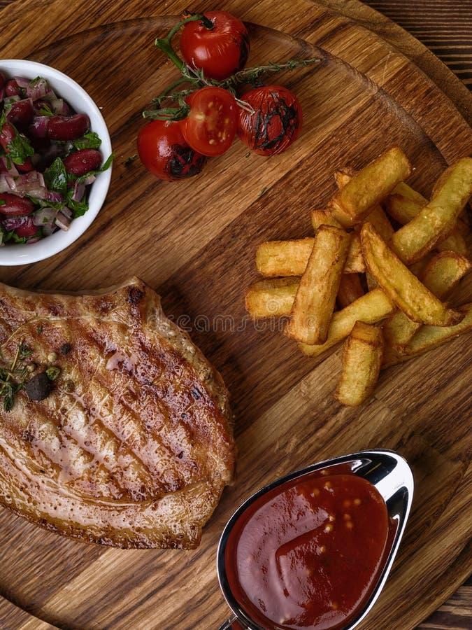 Roasted pork steak on ribs. royalty free stock photo