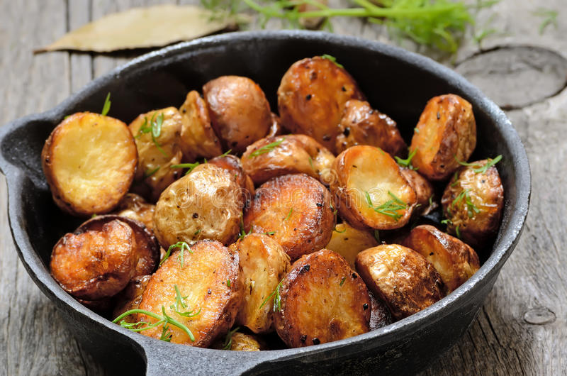 Roasted potato in a frying pan royalty free stock image