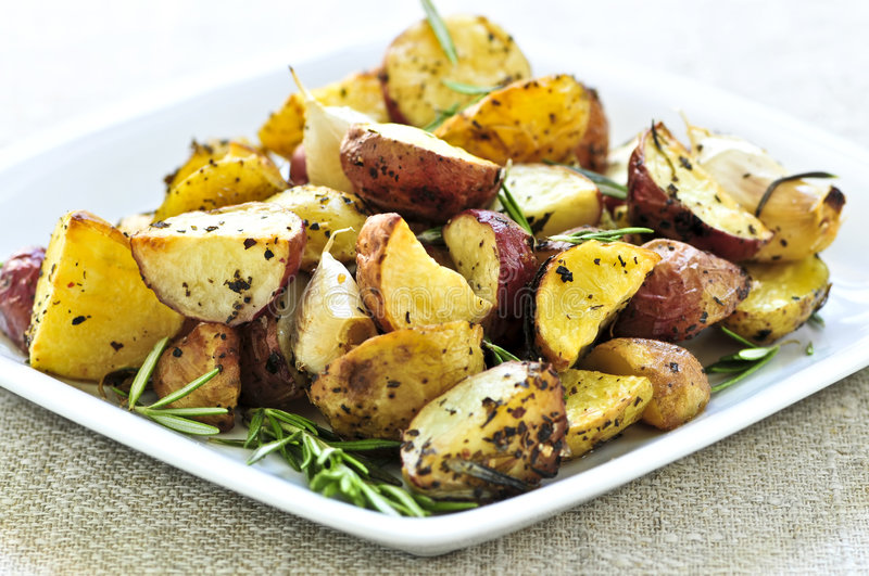 Roasted potatoes. Herb roasted potatoes served on a plate stock images