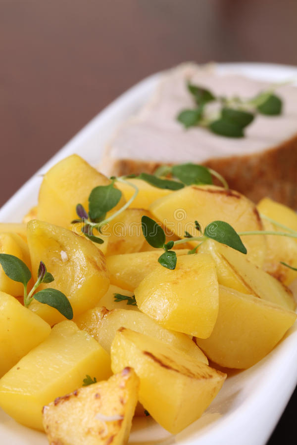 Roasted Potatoes And Tuna Steak Royalty Free Stock Photography