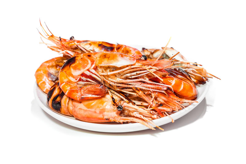 Roasted Prawn delicious seafood in white plate isolated on white. Background, ready for eat stock images