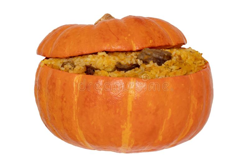 Roasted pumpkin. Close-up of baked whole pumpkin stuffed with roasted rice pot made from rice, onions, carrots, garlic, pumpkin stock photography