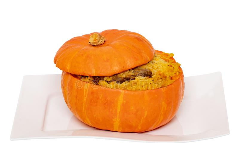 Roasted pumpkin. Close-up of baked whole pumpkin stuffed with roasted rice pot made from rice, onions, carrots, garlic, pumpkin stock photo