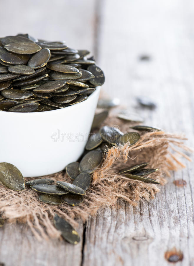 Free Roasted Pumpkin Seeds On Wood Royalty Free Stock Photography - 33814537