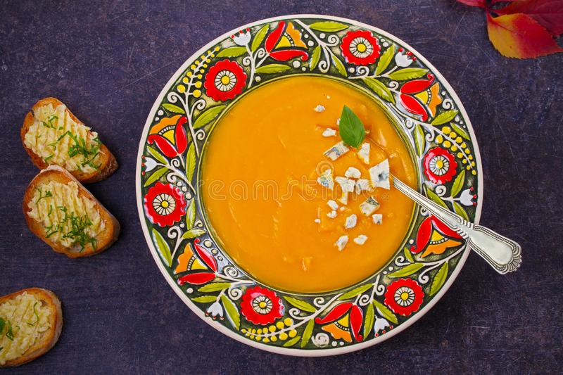 Roasted Pumpkin Soup with Blue Cheese and Garlic Butter Toasts. Butternut Squash Soup. Vegetarian dish. overhead, horizontal stock photos