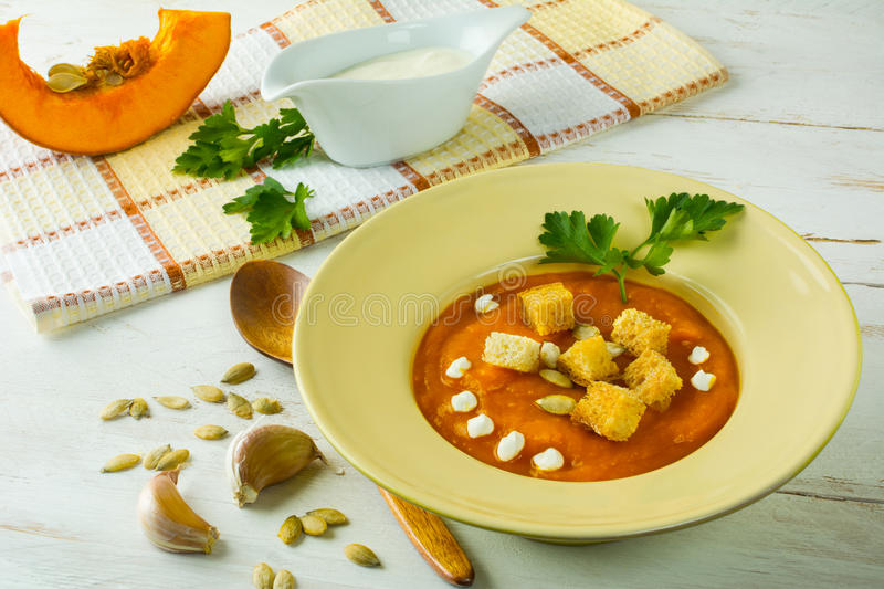 Roasted pumpkin soup with garlic croutons stock images