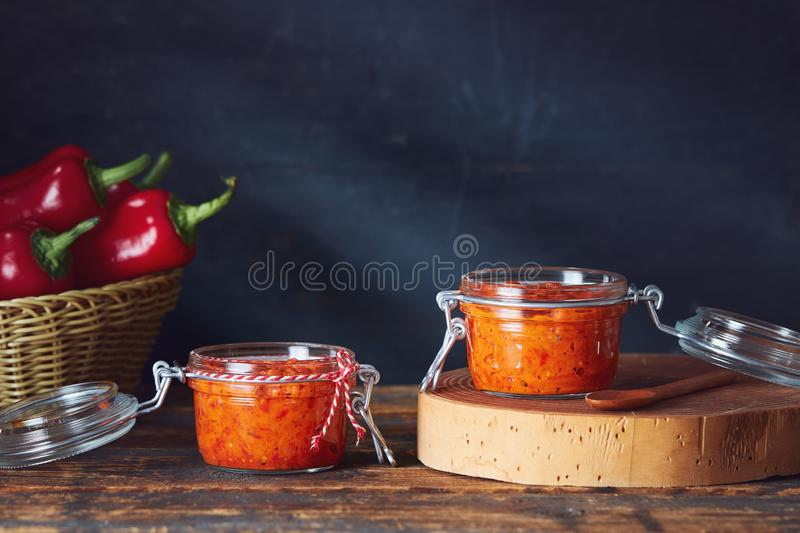 Roasted Red Pepper Relish Ajvar. In jars on table stock images