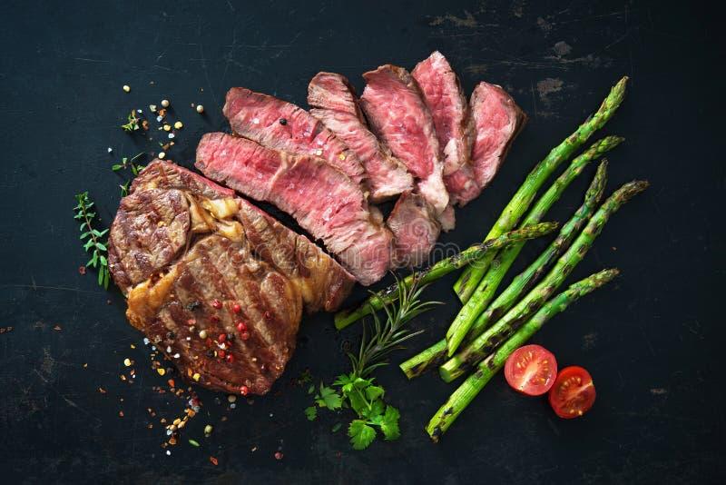 Roasted rib eye steak with green asparagus royalty free stock photo