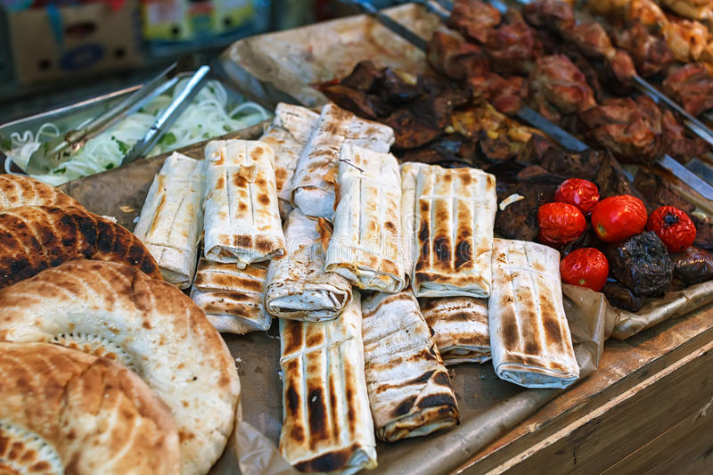 Roasted rolls of bread lavash filled with herbs feta cheese. Roasted rolls of bread lavash filled with herbs and feta cheese. Greek pita, indian chapati royalty free stock photography