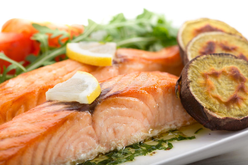 Roasted salmon fillets. With sweet potatoes stock photography