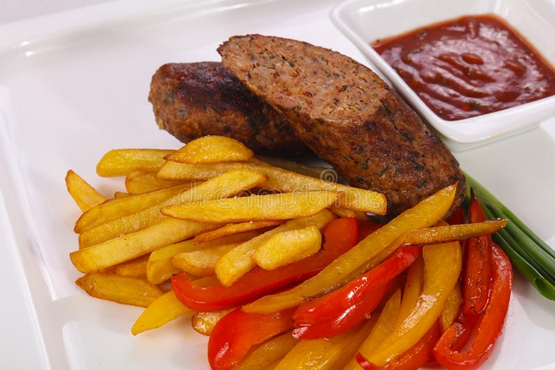 Roasted sausage with fried potato royalty free stock photo