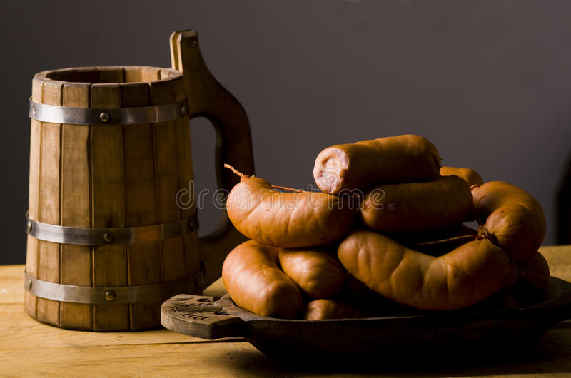 Roasted sausages and beer royalty free stock photography