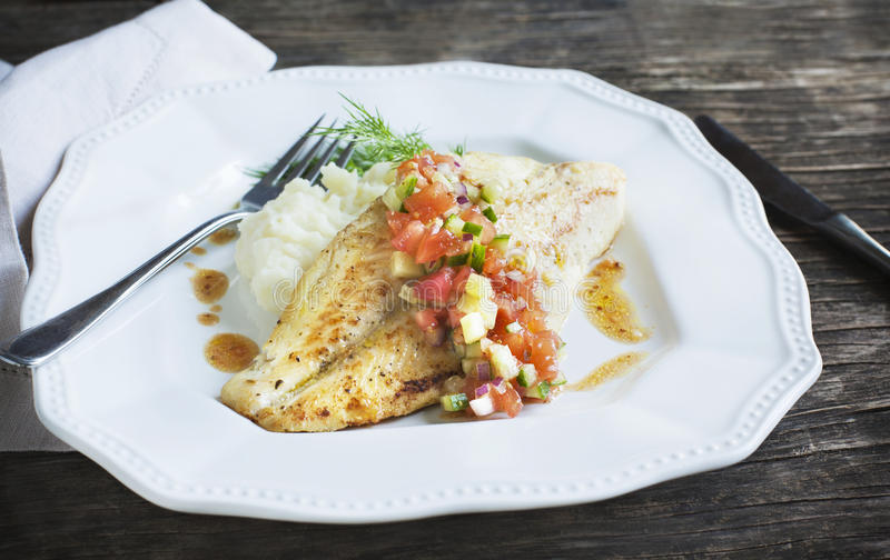 Roasted seabass fillets with sauce Las Vegas Salsa. Roasted seabass fillets with sauce Las Vegas Salsa and mashed potato stock image