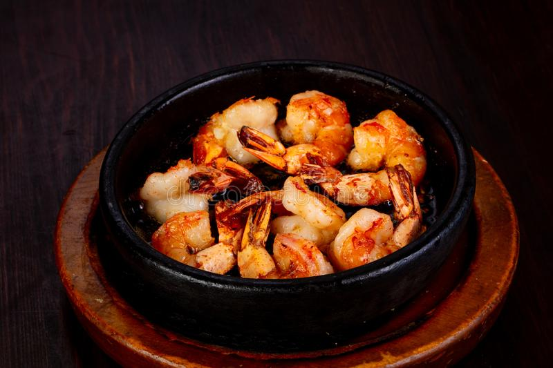 Roasted shrimps in the pan stock images