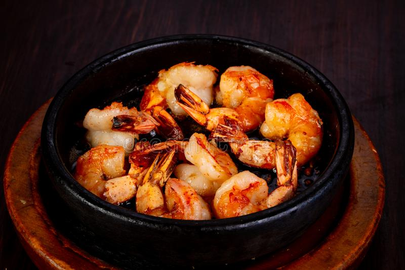 Roasted shrimps in the pan royalty free stock photos