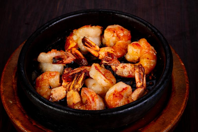 Roasted shrimps in the pan stock photos