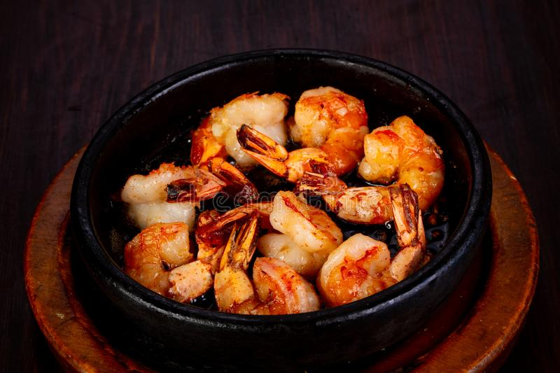 Roasted shrimps in the pan stock image