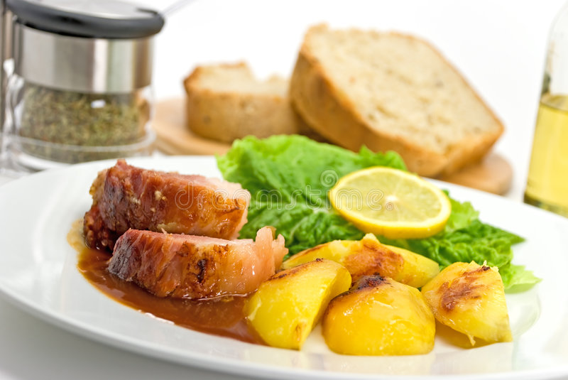 Download Roasted Slices Of Pork With Lettuce And Fried Pota Stock Images - Image: 8118524