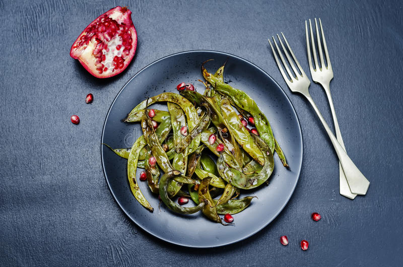 Roasted snap green beans with Pomegranate royalty free stock images