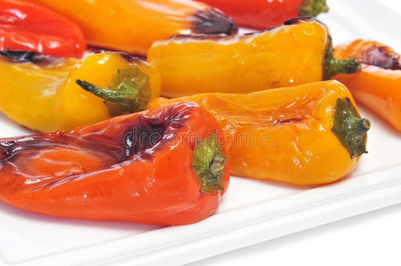 Roasted sweet bite peppers of different colors stock photography