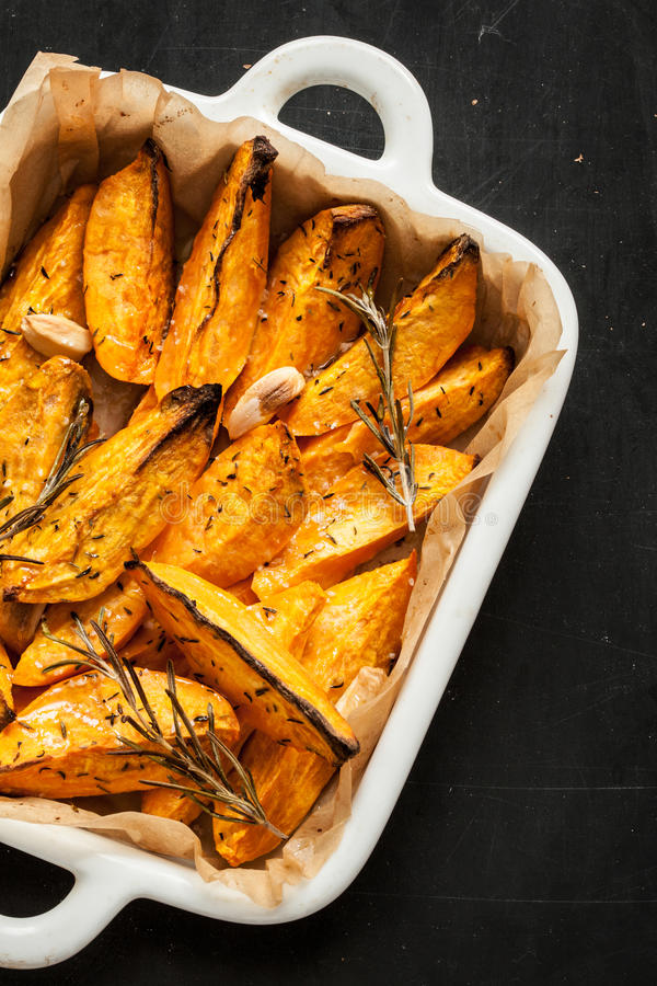 Free Roasted Sweet Potatoes In White Ceramic Dish From Above Royalty Free Stock Photos - 65519788