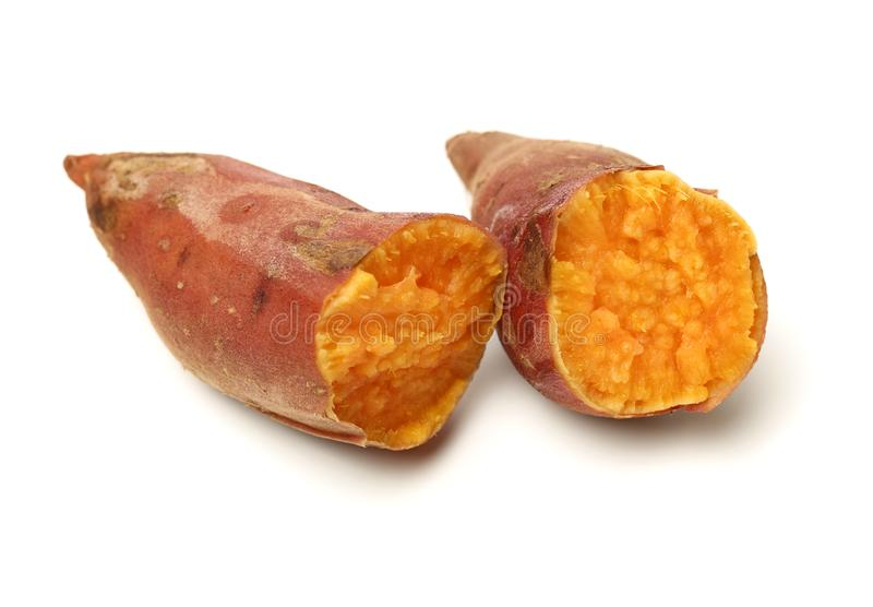 Roasted sweet potatoes. On a white background royalty free stock photos