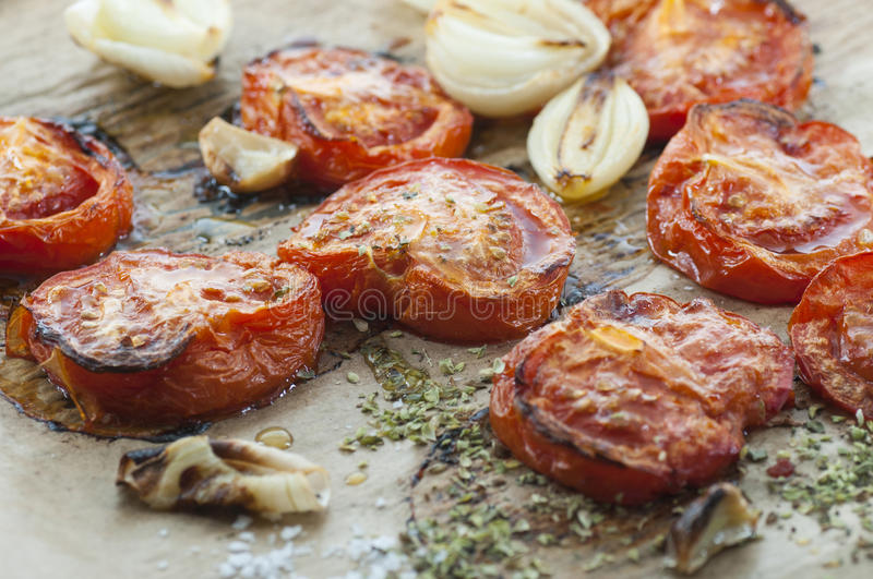 Roasted Tomato. Oven roasted tomato, onion and garlic spiced with oregano and sea salt royalty free stock images