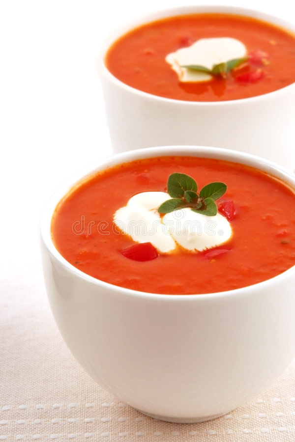 Roasted Tomato Soup. Roasted tomato and herb soup, with capsicum and yoghurt royalty free stock photo