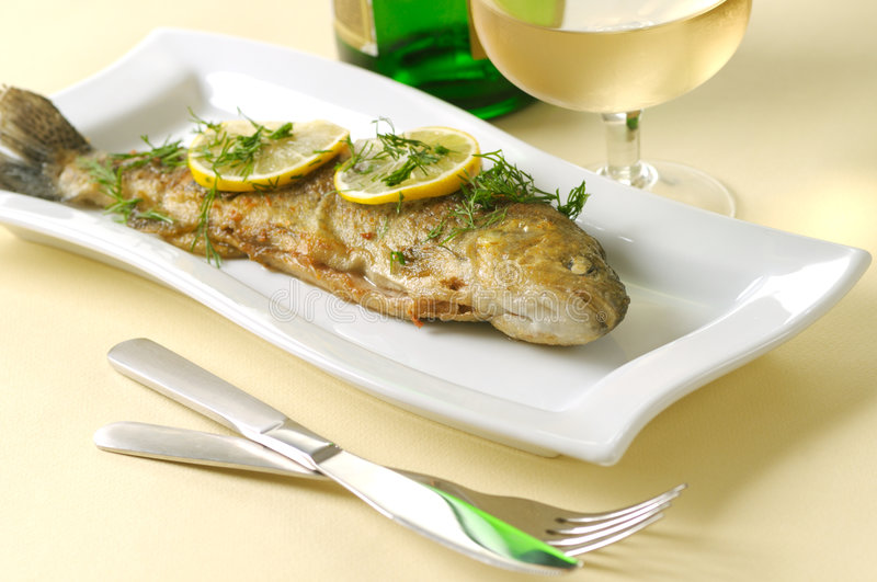 Roasted trout with lemon and dill royalty free stock image