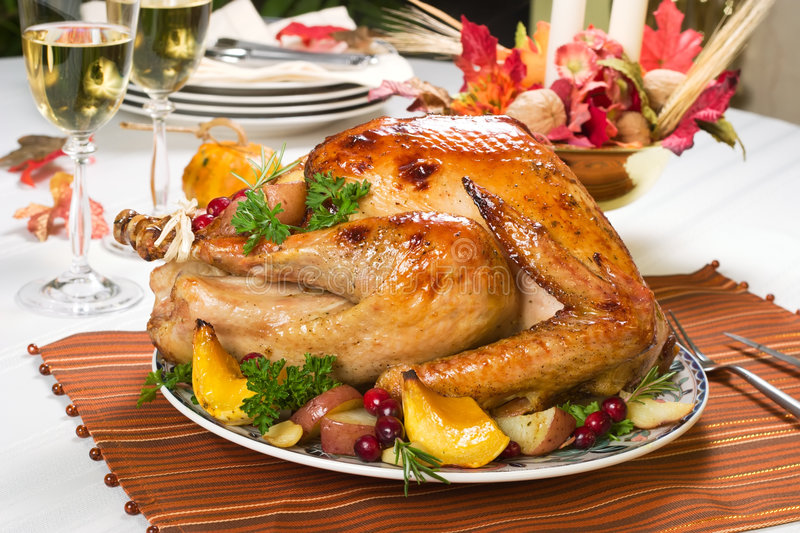 Roasted turkey. Feasting backed turkey on holiday table ready to eat royalty free stock photography