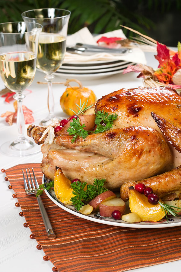 Roasted turkey. Feasting backed turkey on holiday table ready to eat royalty free stock images