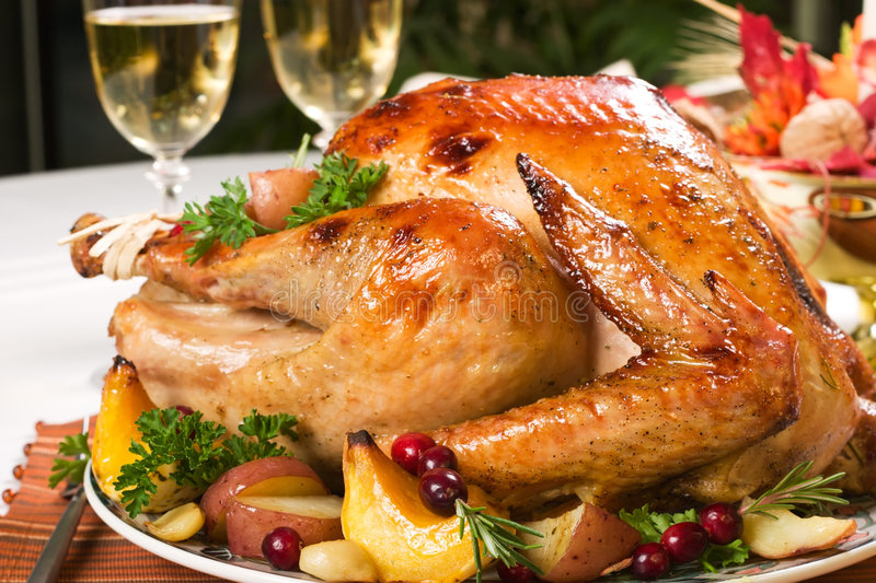 Roasted turkey. Feasting backed turkey on holiday table ready to eat stock image